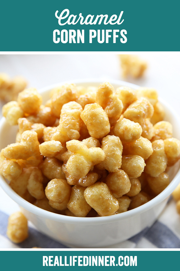 bowl full of corn puffs covered in delicious caramel. they are sitting on a blue and white stripped cloth