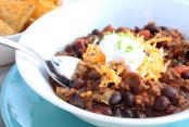Chili with ground beef, black beans, kidney beans and delicious tomato and spices. topped with cheese and sour cream