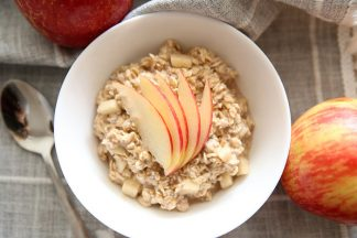 Apple Pie flavored oatmeal with sliced red apple on top.