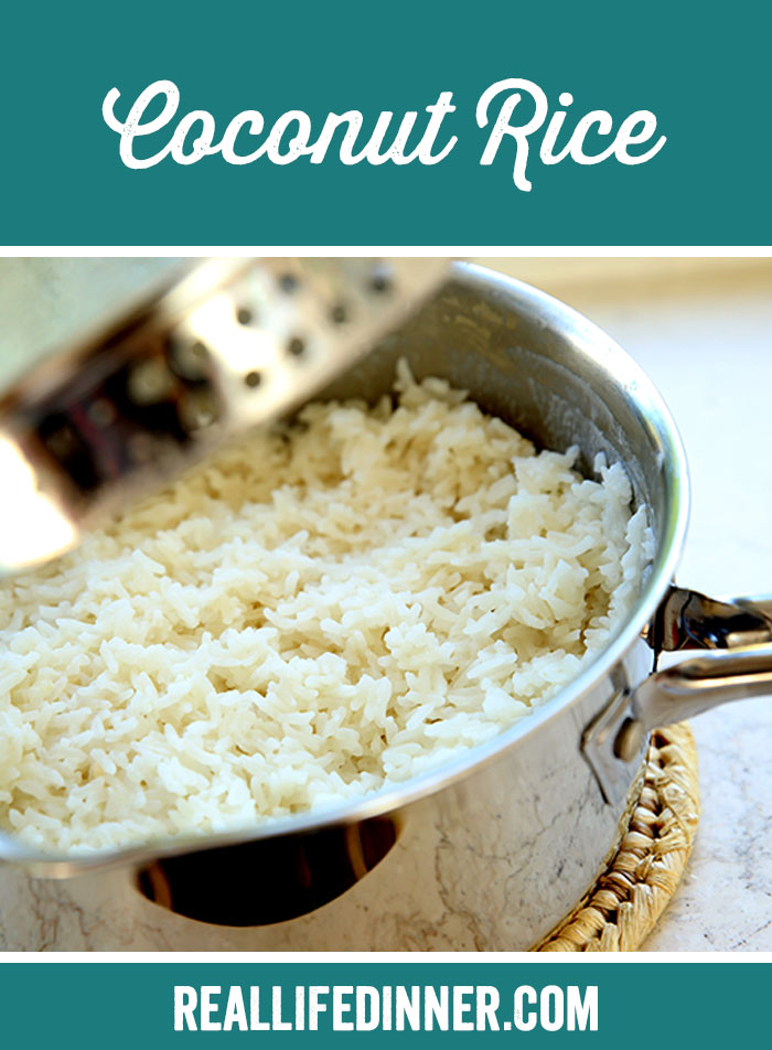 Picture of a pot full of coconut rice. the pot is a stainless steel 2 quart sauce pan. the lid is partially off in the picture
