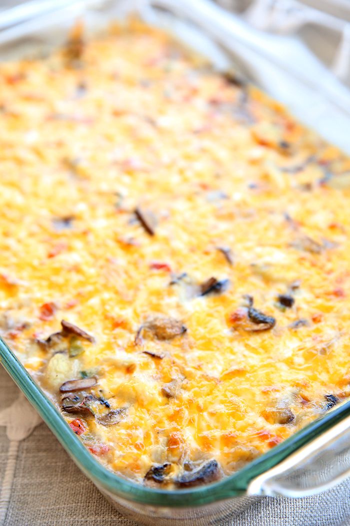a 9 x13 pan full of creamy and cheese company cauliflower.