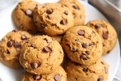 large pumpkin chocolate chip cookies on a white plate