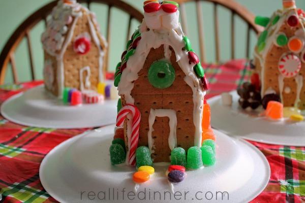 three little graham cracker gingerbread houses