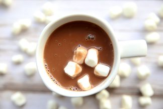 a white mug of hot chocolate with five white marshmallows
