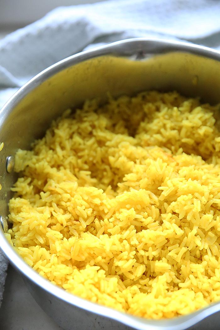 A silver pan full of Ecuadorian Yellow Rice