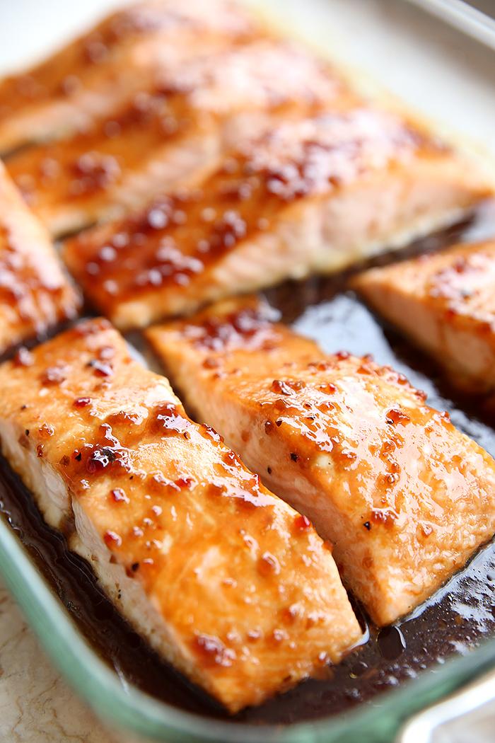 A 9x13 pan several fillets of Baked Teriyaki Salmon sitting in a teriyaki sauce.
