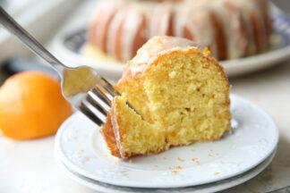 Form taking a bite of Whole Orange Cake