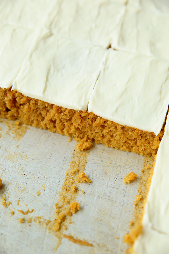 A cookie sheet of the Best Pumpkin Squares with a few pieces cut out.